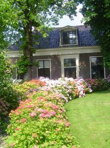Familieaccommodatie in woonboerderij met grote tuin